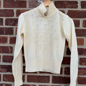 Easel sweater with eyelet detailing. Size small